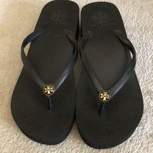 Tory Burch wedge flip flops in black